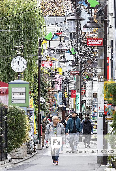 People walking past shops  Harajuku  Tokyo  Honshu  Japan  Asia