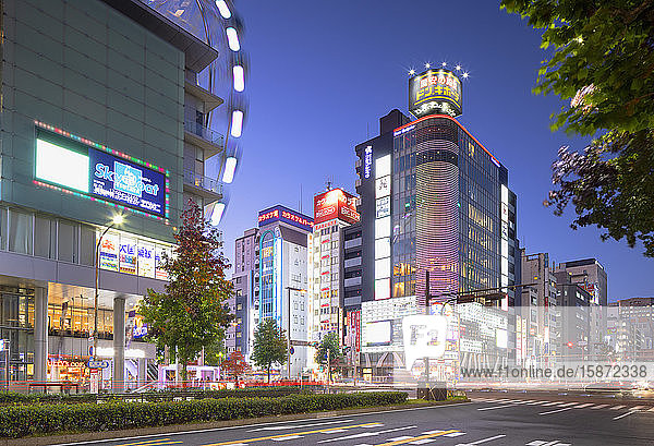Ferris wheel and shopping street at dusk  Nagoya  Honshu  Japan  Asia