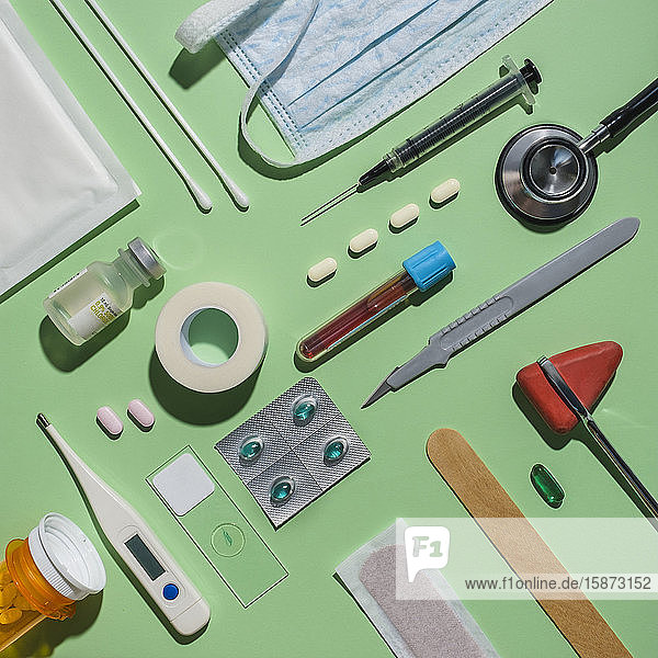 Medical supplies on green background Medical supplies on green background