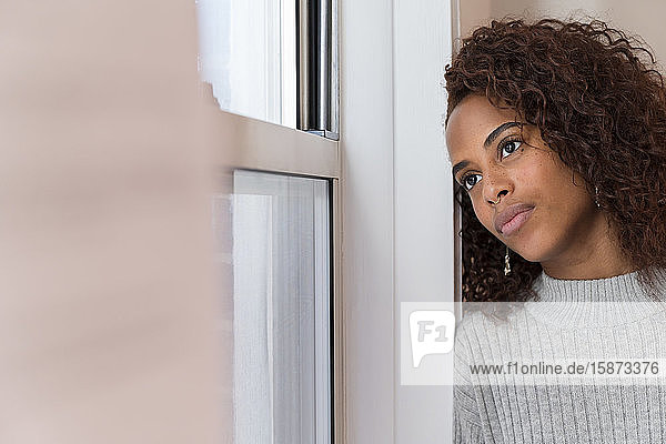 Woman looking out window Woman looking out window