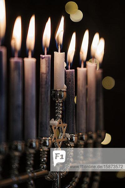 Lit candles in menorah Lit candles in menorah
