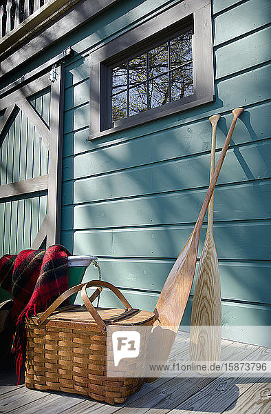 Oars and picnic supplies by blue wall Oars and picnic supplies by blue wall