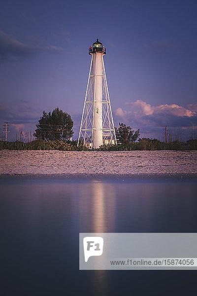 USA  Florida  Boca GrandeLighthouse reflecting in sea at night
