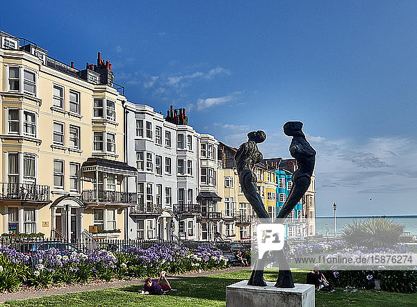 UK  East Sussex  south coast of England  City of Brighton and Hove  Tay sculpture by Romany Mark Bruce 2009. 'A row of what once were individual town houses but have now been converted into apartments. These are in Hove. Brighton is located on the south coast of England and forms part of the municipality of the City of Brighton and Hove  Brighton's location has made it a popular destination for tourists and is the most popular seaside destination in the UK for overseas tourists