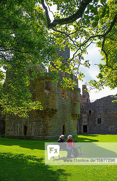 Kirkwall  Orkney  Scoland  An elderly couple sitting in the garden of the Bishop's and Earl's palace