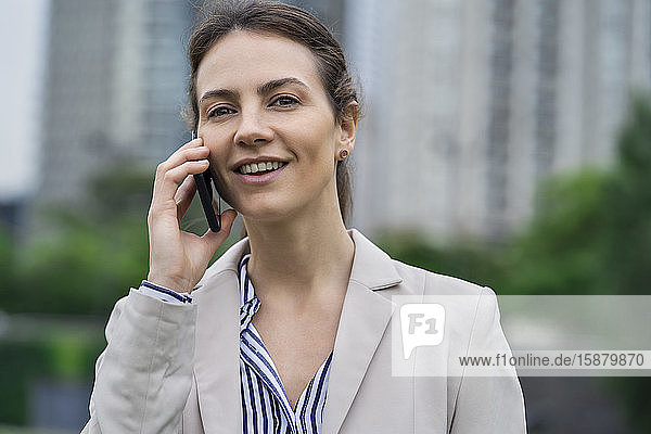 Close-up of businesswoman talking on smartphone
