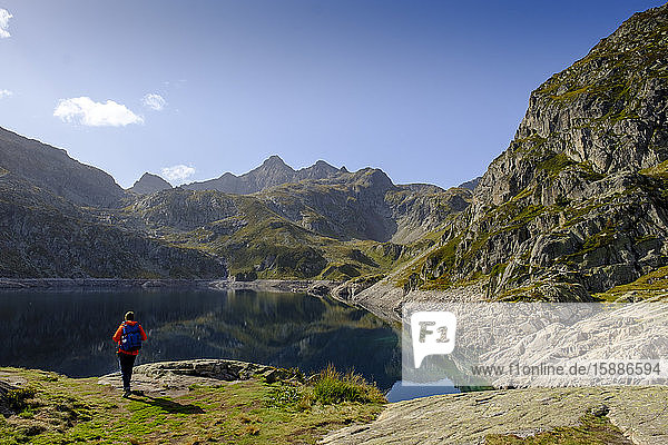 France  Pyrenees-Atlantiques  Laruns  Lone hiker at Lac dArtouste in Ossau Valley