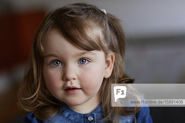 Portrait of toddler girl with blue eyes