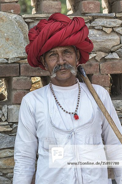 Indian man  member of the Rabari tribe  with a red turban  Bera  Rajasthan  India.
