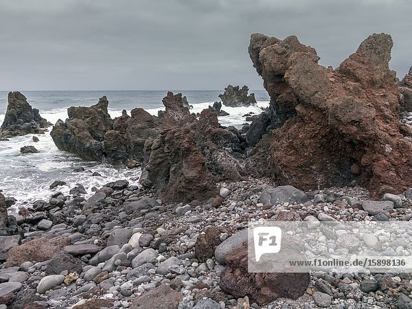 Lava and waves at The Hervideros in Lanzarote. Canary Islands. Spain. Europe.