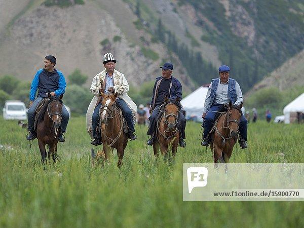 Spectator coming by horse.Folk Festival commemorating the origin myth the Tien Shan Maral (Tian Shan wapiti)  an origin myth of the Kyrgyz tribes. Near Tasch Baschat  Naryn region. Asia  Central Aisa  Kyrgyzstan
