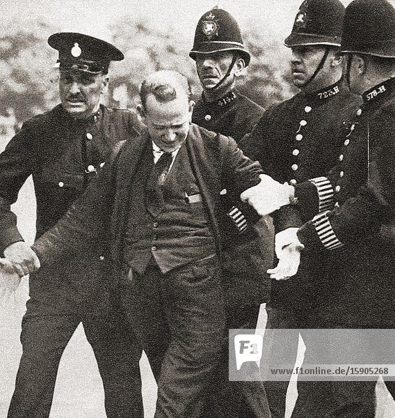 EDITORIAL George McMahon under arrest for producing a revolver with intent to alarm king Edward VIII  1936  he was sentenced to 12 months imprisonment and hard labor. George Andrew Campbell McMahon  d. 1970  aka Jerome Bannigan. From The Coronation Souvenir Book  published 1937.