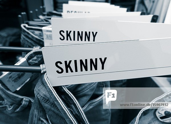 Skinny jeans display in clothing store.