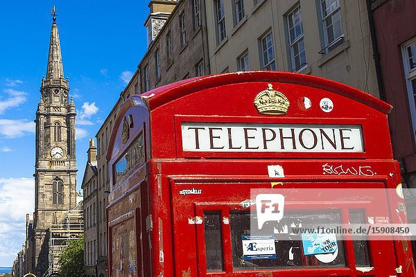 Typical British red telephone booth  The Tron Kirk church on background  Royal Mile  Old Town  Edinburgh  Scotland  United Kingdom  Europe.