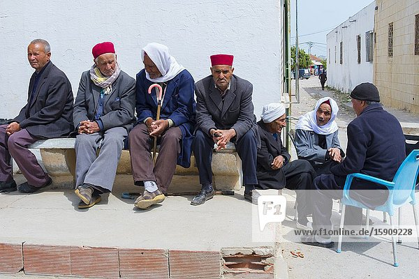 Old men in a street. Tunisia. Africa.