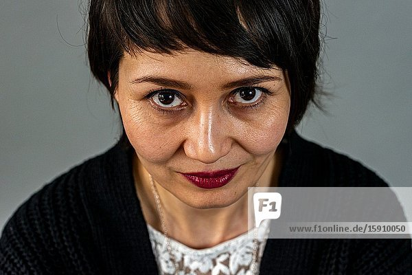 Tilburg  Netherlands. Studio Portrait of an adult Dutch woman and mother with Indonesian roots.