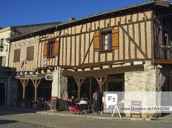 Half-timbered buildings and cafes  Place de la Halle  Villereal  Lot-et-Garonne Department  Nouvelle-Aquitaine  France.