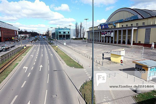 Europe  Poland  Lodz  March 2020  empty streets of city center during the coronavirus pandemic  buildings of Sukcesja shopping center on left and Expo exibition hall on right  Politechnika Alley usually full of people.