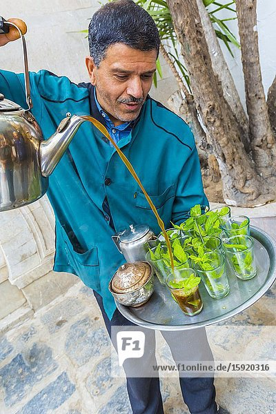 Man pouring mint tea at medina. Tunis city. Tunisia  Africa.