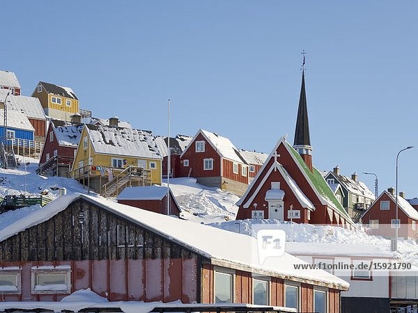 The new church. Winter in the town of Upernavik in the north of Greenland at the shore of Baffin Bay. America   Denmark  Greenland.