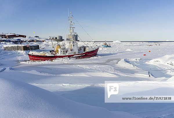 Frozen harbour. Winter in the town of Upernavik in the north of Greenland at the shore of Baffin Bay. America   Denmark  Greenland.