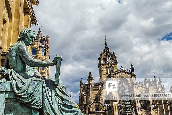 David Hume statue and St Giles' Cathedral  or the High Kirk of Edinburgh  Royal Mile  High Street  Old Town  Edinburgh  Scotland  United Kingdom  Europe.