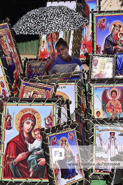 Ethiopia  Gonder  Strret vendor selling religious posters.