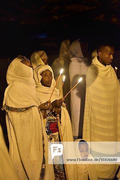Ethiopia  Lalibela  World Heritage Site  Timkat festival  Night vigil  Christian devotees in prayer.