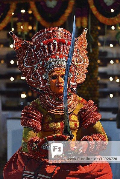 India  Kerala  Kannur region  Performance of Theyyam Puliyur Kannan.