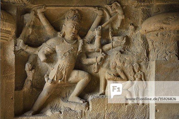 India  Maharashtra  World Heritage Site  Ellora  Cave 29  Shiva killing demon Andhaka before Parvati.
