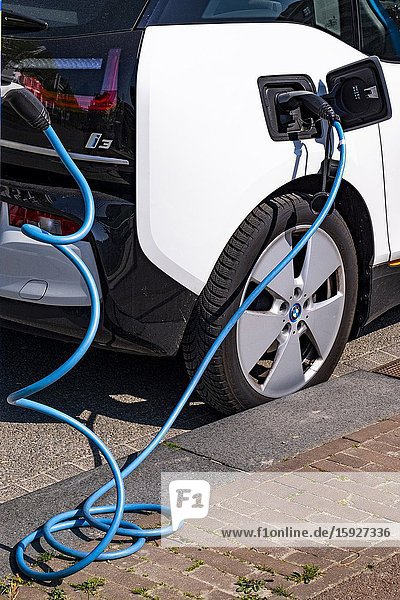 Car being charged at an electric car charging point  Eindhoven  The Netherlands  Europe.