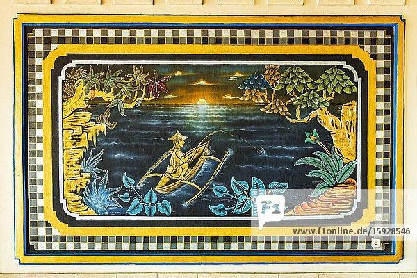 Painting of a Balinese fisherman at Tanah Lot Temple  Bali  Indonesia.