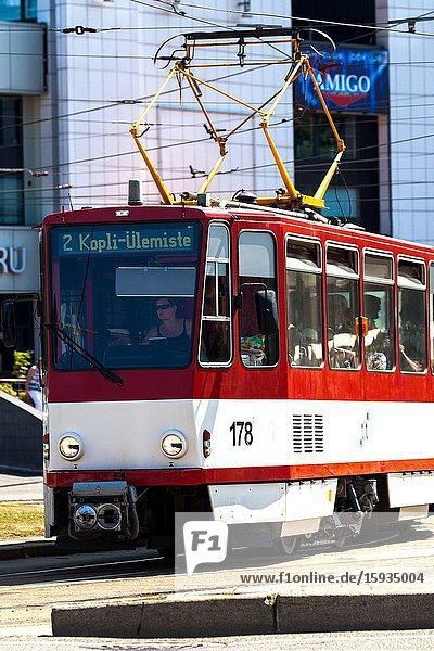 City trams at busy intersection. Tallinn Estonia.