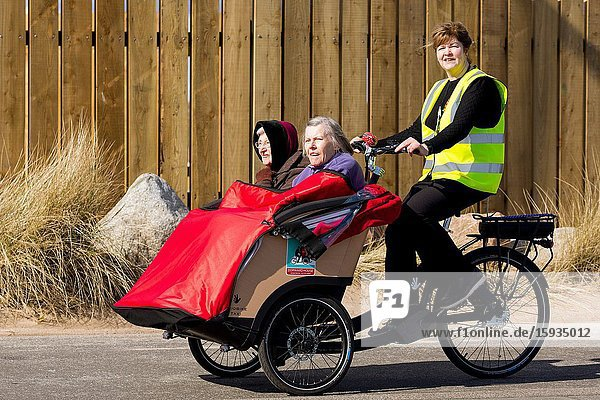 Taking the elderly out for a refreshing trip to beach front. Montrose Scotland UK.