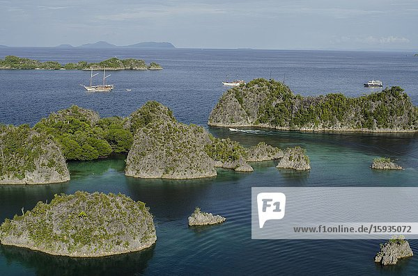 Diving liveaboard boat  Pianemo Viewpoint  Pianemo Island  near Waigeo Island  Raja Ampat  Indonesia.