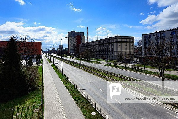 Europe  Poland  Lodz  March 2020  empty streets of city center during the coronavirus pandemic  buildings of Lodz University of Technology (Politechnika Lodzka) on left and student houses on right  Politechnika Alley usually full of students.