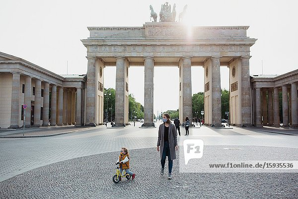 Mother and son walking in Berlin in Corona days.