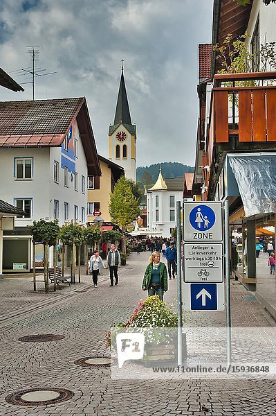 View along Schlossestrasse to Saint Peter and Paul Church  Oberstaufen  Bavaria  Germany.