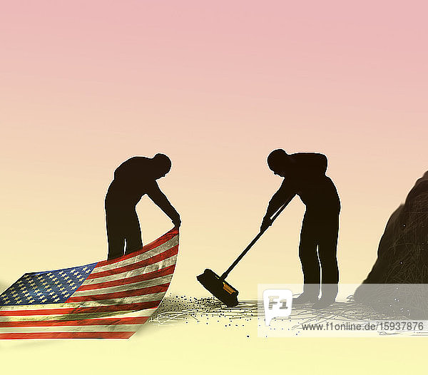 Man sweeping dirt under Stars and Stripes carpet