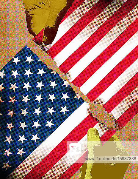 Hands tearing Stars and Stripes flag in two