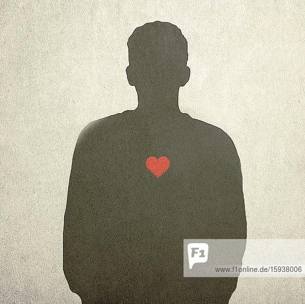 Rotes Herz auf der Silhouette eines Menschen