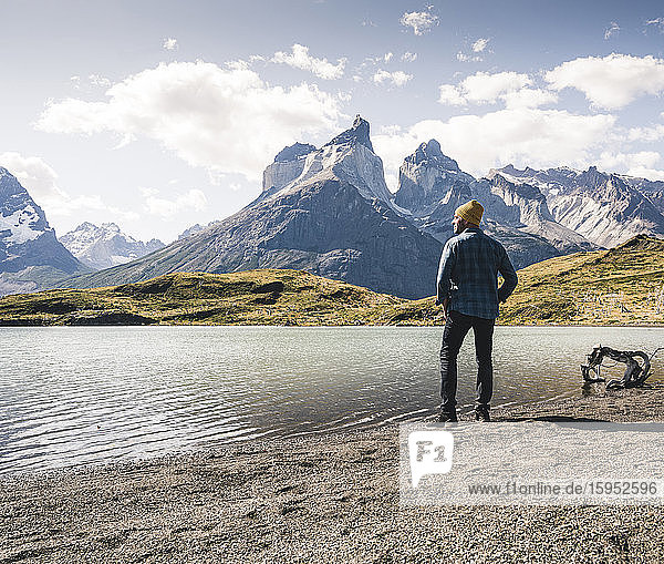 Hiker in mountainscape at lakeside in Torres del Paine National Park  Patagonia  Chile