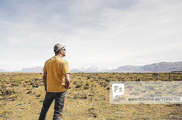 Rear view of man standing in remote landscape in Patagonia  Argentina