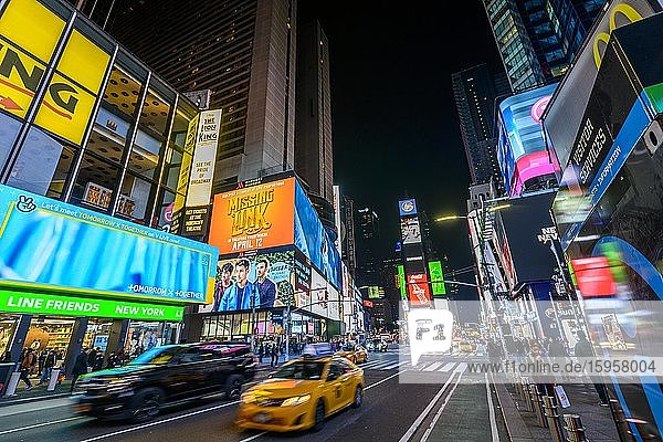 Typical yellow taxi at Times Square at night  Midtown Manhattan  New York City  New York State  USA  North America
