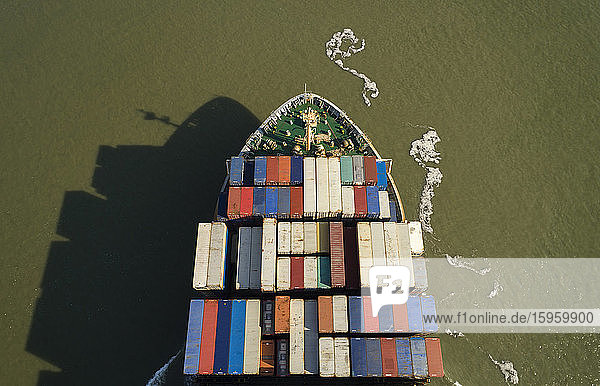 High angle view of large container ship heading towards the port of Antwerp  Belgium.
