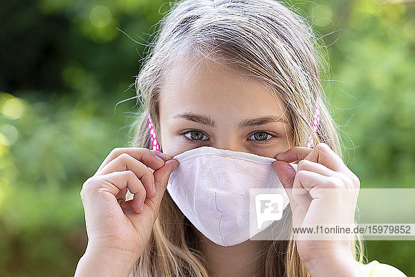 Close-up of girl wearing face mask