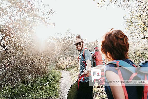 Couple with backpacks on a hiking trip