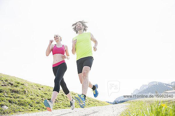 Couple jogging together  Wallberg  Bavaria  Germany