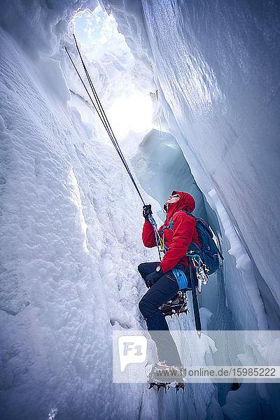 Mountaineer climbing in crevasse  Glacier Grossvendediger  Tyrol  Austria