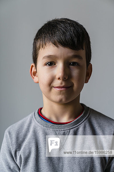 Close-up portrait of cute boy at home